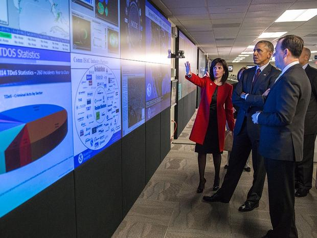 President Barack Obama tours the National Cybersecurity and Communications Integration Center in Arlington, Virginia, Jan. 13, 2015. He is accompanied by Homeland Security Secretary Jeh Johnson, Lisa Monaco, Assistant to the President for Homeland Security and Counterterrorism, and tour guides Dr. Phyllis Schneck, Deputy Under Secretary for Cybersecurity & Communications, and Brigadier General Greg Touhill, (Ret.), Deputy Assistant Secretary for Cybersecurity Operations and Programs. (Official White House Photo by Pete Souza)